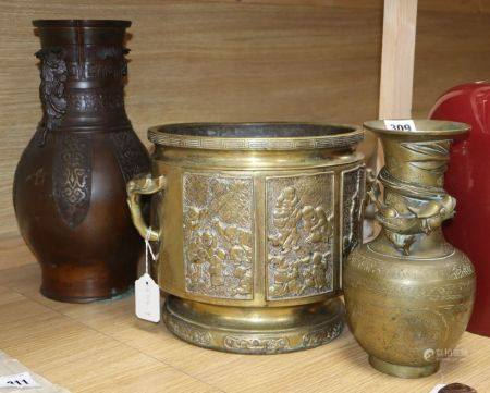 Two Chinese bronze vases and a jardiniere, tallest vase 37cm