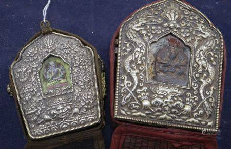 Two Tibetan repousse portable altars, tallest 14.5cm