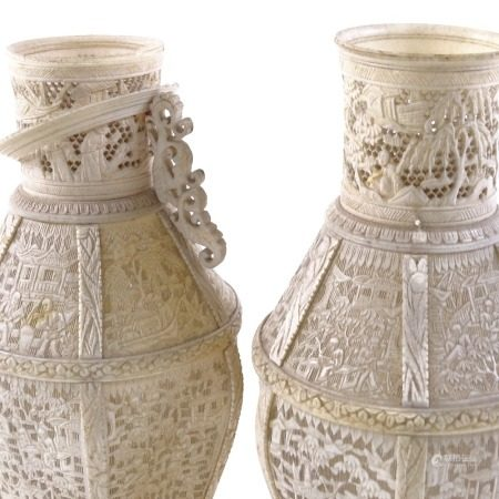 A pair of 19th century Chinese Cantonese ivory vases, carved and pierced sections with village