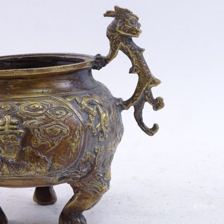 A Chinese bronze censer, dragon handles with Dog of Fo feet and mountain scenes, height 11cm
