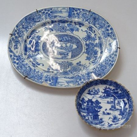 A Chinese blue and white dish, signed, length 34cm, and a Chinese blue and white dish with design of