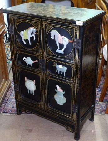 A Chinese design black lacquered and gilded side cabinet, with applied hardstone decorated panels,