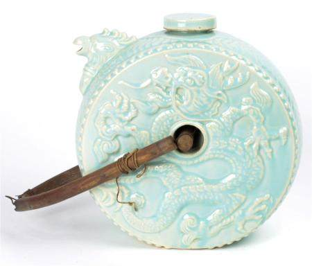 Chinese celadon circular ewer, the drum shape decorated with
