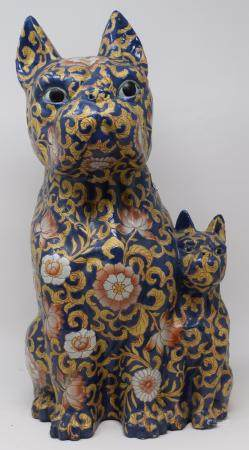 A pair of pottery lamps, 35 cm high over fitments, and a pottery dog group (3)