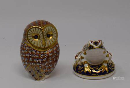 A Royal Crown Derby owl, 12 cm high, two other Royal Crown Derby weights, a Royal Doulton Oliver