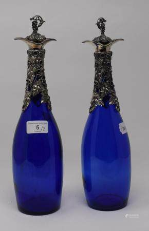 A pair of blue glass decanters, with plated mounts and stoppers, 33.5 cm high (2) Report by RB