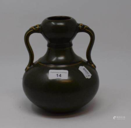 A Chinese green glazed pottery double gourd vase, with twin handles, 19 cm high generally good, a