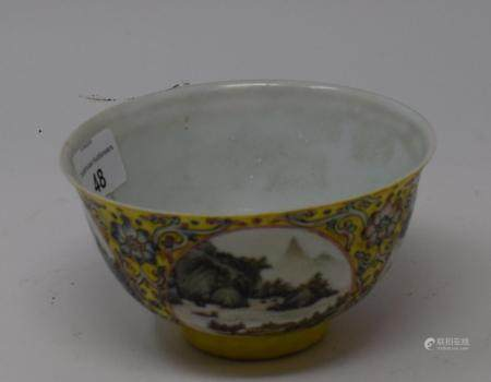 A Chinese porcelain medallion bowl, decorated vignettes of mountain scenes on a yelllow ground