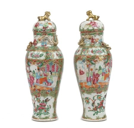 A pair of Canton famille-rose slender baluster vases and covers, 19th century,