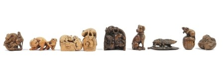A group of eight late Japanese wood netsukes of animals, including dogs, a frog, a cat,
