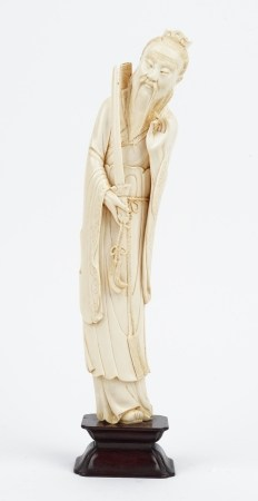 A Chinese ivory figure of a dignitary, early 20th century,