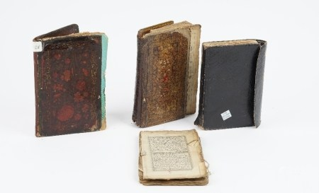 Four Islamic manuscripts, circa 19th century, including two Quran manuscripts and two prayer books,