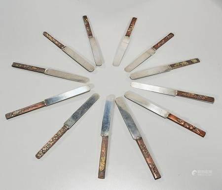 SET OF TWELVE JAPANESE KNIVES