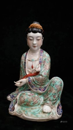 A Chinese Famille Rose Porcelain Figure Of Guanyin