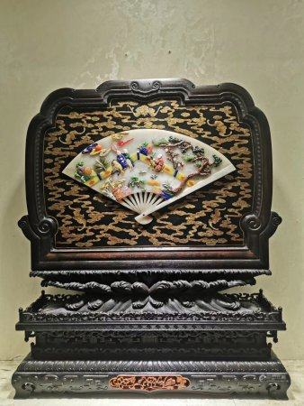 A Chinese Rosewood Gold-Lacquered Screen