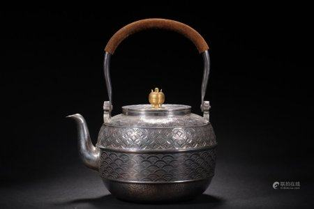 A Chinese Silver Pot With Handles