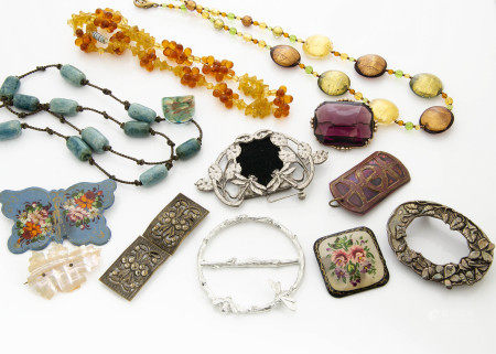 A collection of miscellaneous jewellery, comprising various necklaces, brooches, buckles and