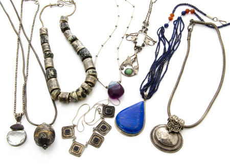 A collection of silver and white metal necklaces, comprising a simulated turquoise Art Nouveau