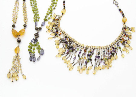 A continental multi gem set fringe necklace, with citrines, amethysts, garnets and white metal