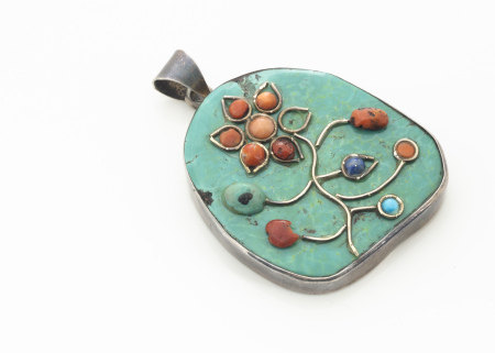 A turquoise, coral and lapis lazuli white metal pendant, of floral design, bale marked 925, 6.2cm