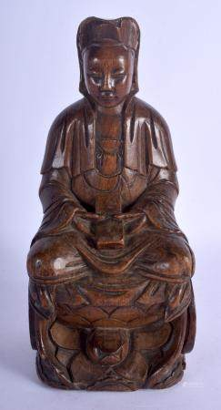 A 17TH/18TH CENTURY CHINESE CARVED WOOD FIGURE OF AN IMMORTA