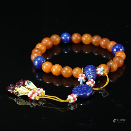 A CHINESE BEESWAX BEADS HAND STRING