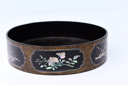 A CHINESE LACQUERBOX INLAID WITH MOTHER-OF-PEARL AND GOLDEN-PAINTED