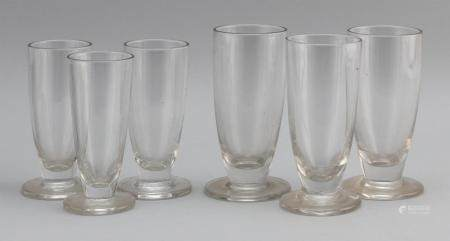 SIX ENGLISH ALE GLASSES Each fluted and with spreading foot.