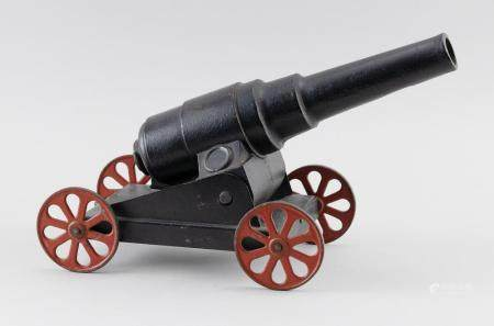 "CAST IRON AND TIN CANNON Painted red and black. Length 14""."