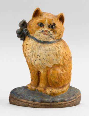 "CAST IRON SEATED CAT DOORSTOP Unmarked. Height 7.5""."