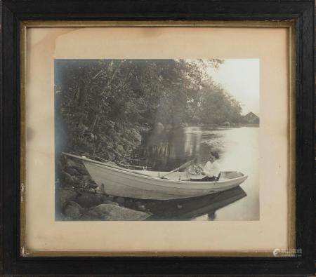 "PHOTOGRAPH OF A YOUNG LADY SEATED IN A GUIDE BOAT 15.5"" x 20"