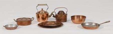 SEVEN PIECES OF COPPER COOKWARE Two plates, two teapots, a c