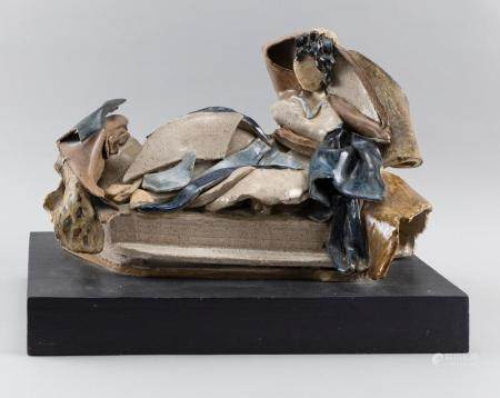 POTTERY SCULPTURE OF A RECLINING FEMALE ON A COUCH Height 13