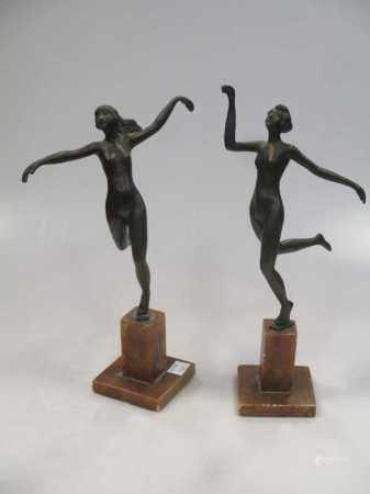 A pair of 1930s bronzed spelter ladies in the manner of Josef Lorenzl
