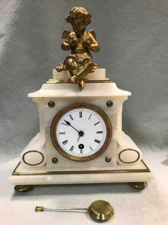 A French late 19th century gilt metal and alabaster timepiece,