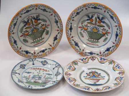A pair of Continental tin glazed dishes and two Delft plates (4)