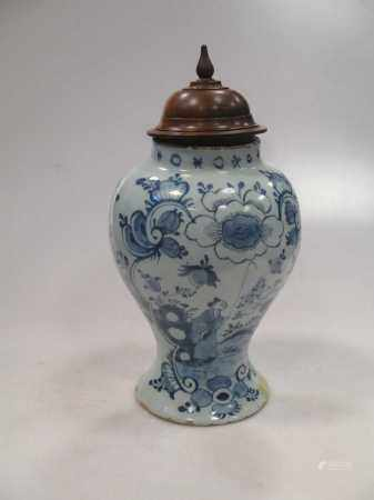 An 18th century Delft blue and white vase 30cm high with lid