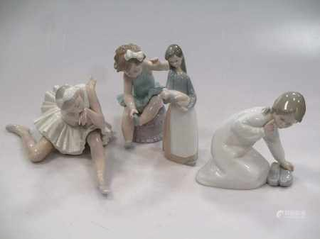 Four Lladro figures, to include a Ballerina, a girl holding a pig etc