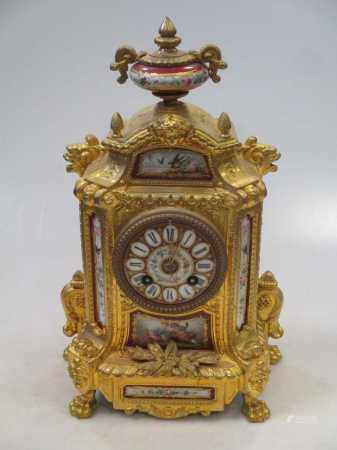 A late 19th century French gilt metal and porcelain mounted mantel clock, with bell striking drum