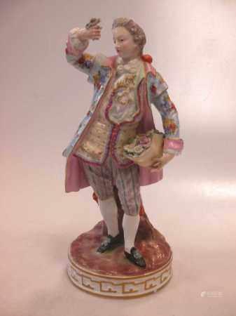 A 19th century Meissen figure of a gentleman,