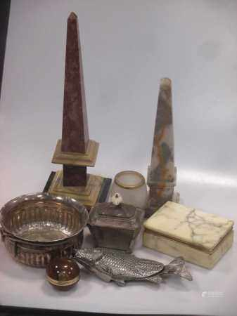 Two stone obelisks and various stone boxes Matrioska dolls featuring Tsar Nicholas II and his family