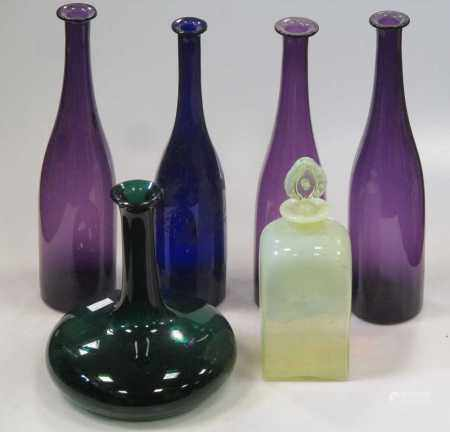 Three amethyst glass carafes, another blue glass example with etched decoration and others
