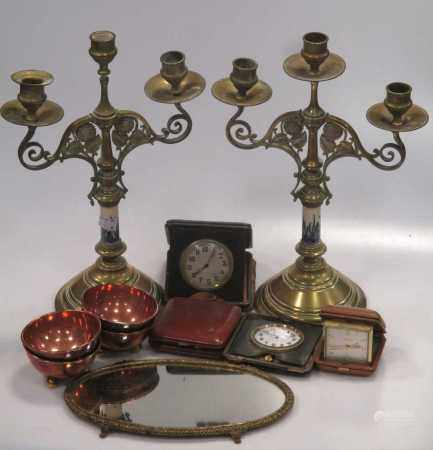 A pair of brass and ceramic three light candelabra with flowerhead design, 37cm high, lacking drip