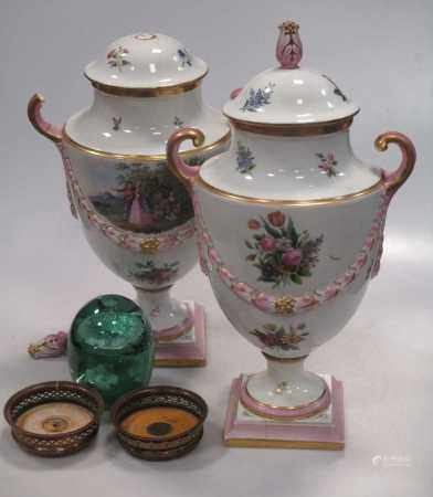 A pair of Continental urns and covers decorated with figures and raised festoon work, 37cm high,