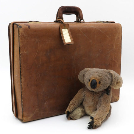 A Vintage Leather Case and Antique Koala Beer