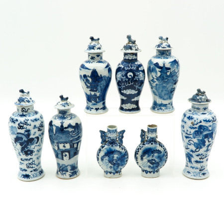 A Collection of 8 Garniture Vases