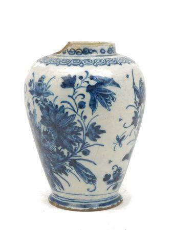 A tin glazed earthenware blue and white jar, probably 18th century, decorated with flowers, damages,