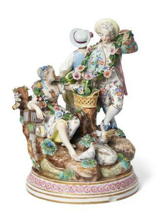 A Continental Meissen style porcelain figure group, late 19th century, set in a natural landscape, a