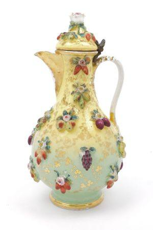 A Continental porcelain ewer, 19th century, with hinged lid, overall applied with fruit, flowers and
