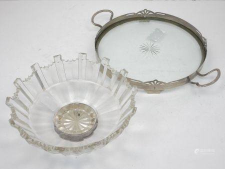 A pewter mounted glass tray, of circular form, with two handles and a raised rim with pierced